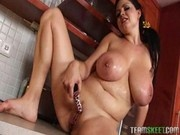 A Big Titty Girl Plays with a dildo