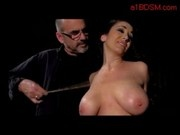 Busty Girl Plug In Butt Spanked With Stick Sucking Dildo While Whipped By Master In The Dungeon