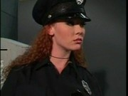 redhead in latex cop outfit
