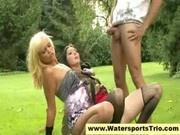 Piss loving babes and horny guy have watersports trio outdoo