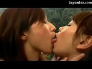 2 Cute Girls Kissing Passionately On The Hotels Balcony In The Mountains