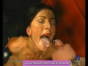 Brunette bukkake slut completely coated in cum
