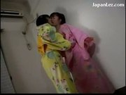 Asian girl getting her pussy fingered while standing by girl