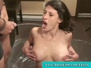 Brunette drinking piss and sucking cock