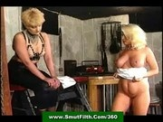 Blonde slavegirl worshipping her lesbian Mistress' shoes