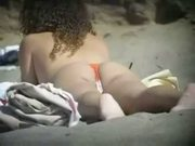 Hot teen topless on the beach