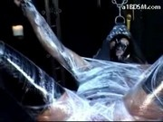 Girl In Mask Wrapped In Foil On The Swing Getting Her Tits Pussy Rubbed By Master In The Dungeon