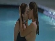 Denise Richards and Neve Campbell kissing