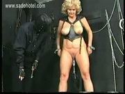 Older slave with big tits got metal clamps with lots of weig