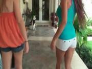 Two amazing latina teens sharing a passionate kiss