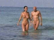 Couple sex on nude beach