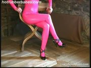 Hot rubber babe spreading hard