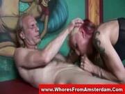 Tattooed redhead hooker sucking off a horny customer