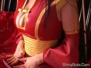 Occidental geisha in latex kimono, big oily tits, shaved pus