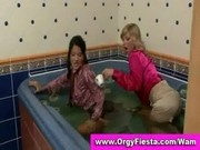 Wam ladies getting their clothes wet in a swimming pool