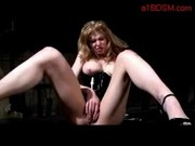 Busty Girl In Latex Corset Fingering Herself Licking Master Boots Spanked In The Dungeon