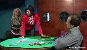 Glamorous watersports trio on a poker table