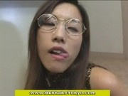 Spectacled japanese cutie gets bukkaked