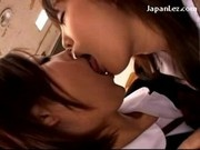 2 Schoolgirls In Uniform Kissing Passionately In The Classroom