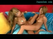 2 Hot Tanned Girls Fingering Rubbing Pussies In Scissor On The Couch