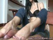 Femdom fetish mistress gives footjob