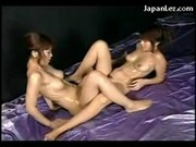 2 Girls Covered With Oil Rubbing Tits Pussies In Different Poses