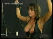 Horny slave with her hands tied is hit with a whip on her as