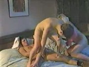 Two milfs fuck a young stud