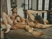 Christy Canyon and another girl do their business to one guy... and each other!