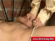 Beautiful mistress gives slave in bondage a cbt lesson