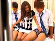 Japanese Girl Gives Blowjob to 2 Guys in Classroom