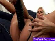 toying shaved pussy with black dildo