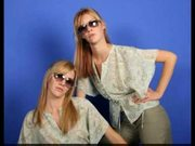 Identical lesbian twins posing together and showing all...