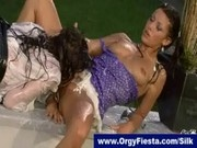 Two fully clothed by very wet lesbians enjoying eachothers pussy