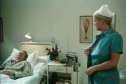 Busty nurse tries to put her breasts' nipples on the mouth o