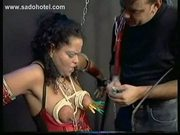 Tied ebony slave in a dungeon with her body and face covered