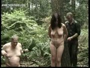 Two master ties horny slave to a tree and fucks her with a d