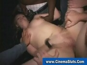 Slut gangbanged by horny perverts in seedy porn theater
