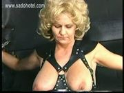 Older slave with big tits gets large metal clamps with heavy