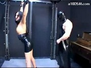 Girl In Pvc Dress Tied Arms Getting Her Tits Rubbed Paddled Pussy Fingered Mouth Fucked In The Dunge