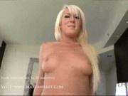 Melanie - Check a blond shaved pussy1