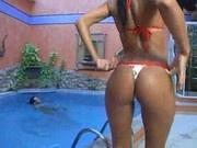 Plumming her tan ass