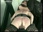 Slave with her ass covered in candlewax gets her butt spanke