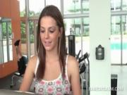 Cute teen beauty shows sexy body in small outfit at the gym
