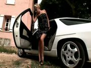 Blonde on a white sport car