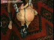 Blond slave with her hands tied with a rope gets spanked on