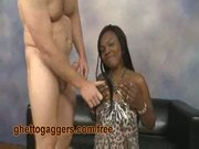 Ebony chick slurps on a fat white dong