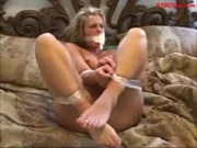 Blonde Girl Tied With Tape Trying To Escapte Getting Her Asshole Fucked With Dildo On The Bed