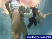 Fully clothed fucksome in a swimming pool