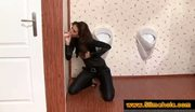 Brunette sucks dick through bathroom hole